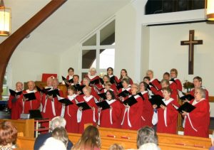 This is a picture of the Henrietta UCC adult choir. The choir robes are red.